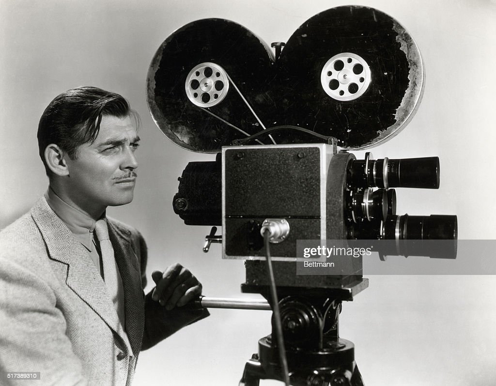 Clark Gable in a publicity photograph for his film Too Hot to Handle, 1938 in which he plays a newsreel reporter