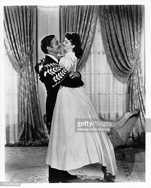 Clark Gable lifting up Vivien Leigh in a scene from the film 'Gone With The Wind' 1939