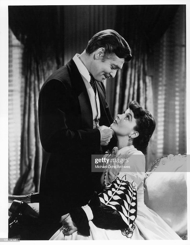 Clark Gable looks lovingly at Vivien Leigh in a scene from the film 'Gone With The Wind' 1939