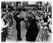 Clark Gable raising Vivien Leigh's hands in front of a large crowd in a scene from the film 'Gone With The Wind' 1939