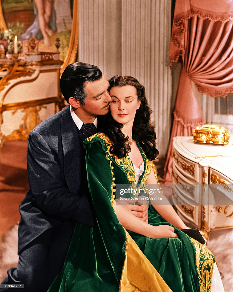 Clark Gable (1901–1960), US actor, and Vivien Leigh (1913-1967), British actress, in a publicity still issued for the film, 'Gone with the Wind', 1939. The drama, directed by Victor Fleming (1889-1949), starred Gable as 'Rhett Butler', and Leigh as 'Scarlett O'Hara'.