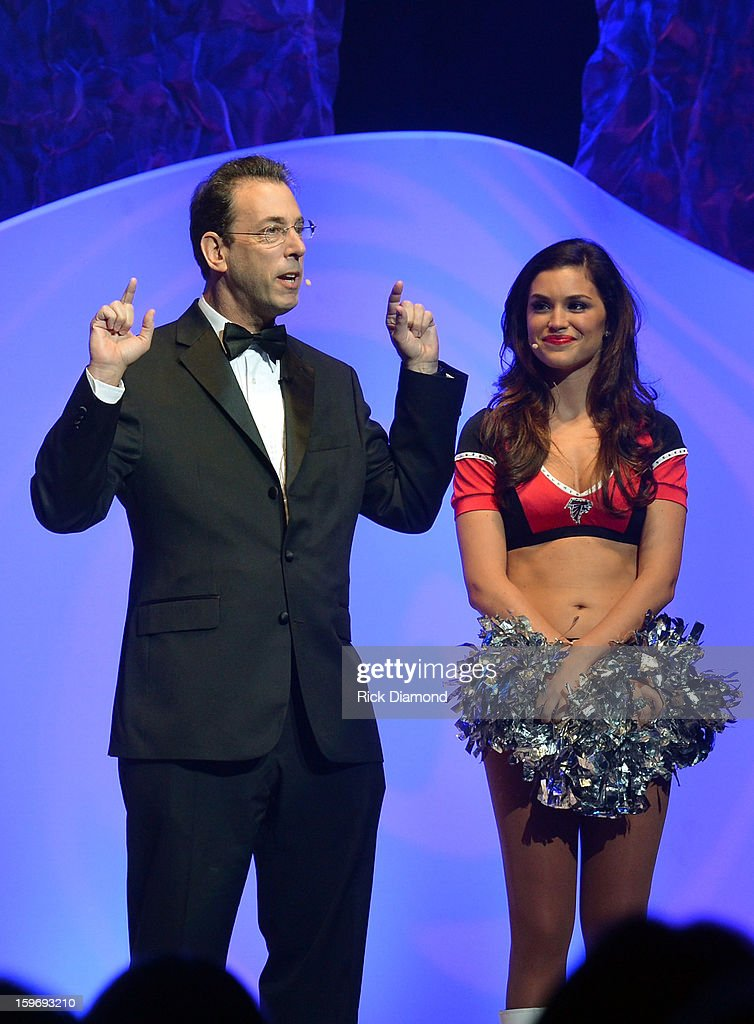 Clark Howard and Atlanta Falcon Cheer Leader attend The Boortz Happy Ending at The Fox Theater on January 12, 2013 in Atlanta, Georgia.