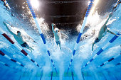 Clark Smith Connor Jaeger and Conor Dwyer of the United States compete in a preliminary heat for the Men's 400 Meter Freestyle during Day One of the...