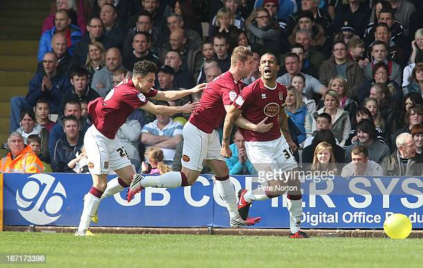 Clarke Carlisle of Northampton Town celebrates with teammates Ben Harding and Lewis Hornby after scoring his sides 1st goal during the npower League...