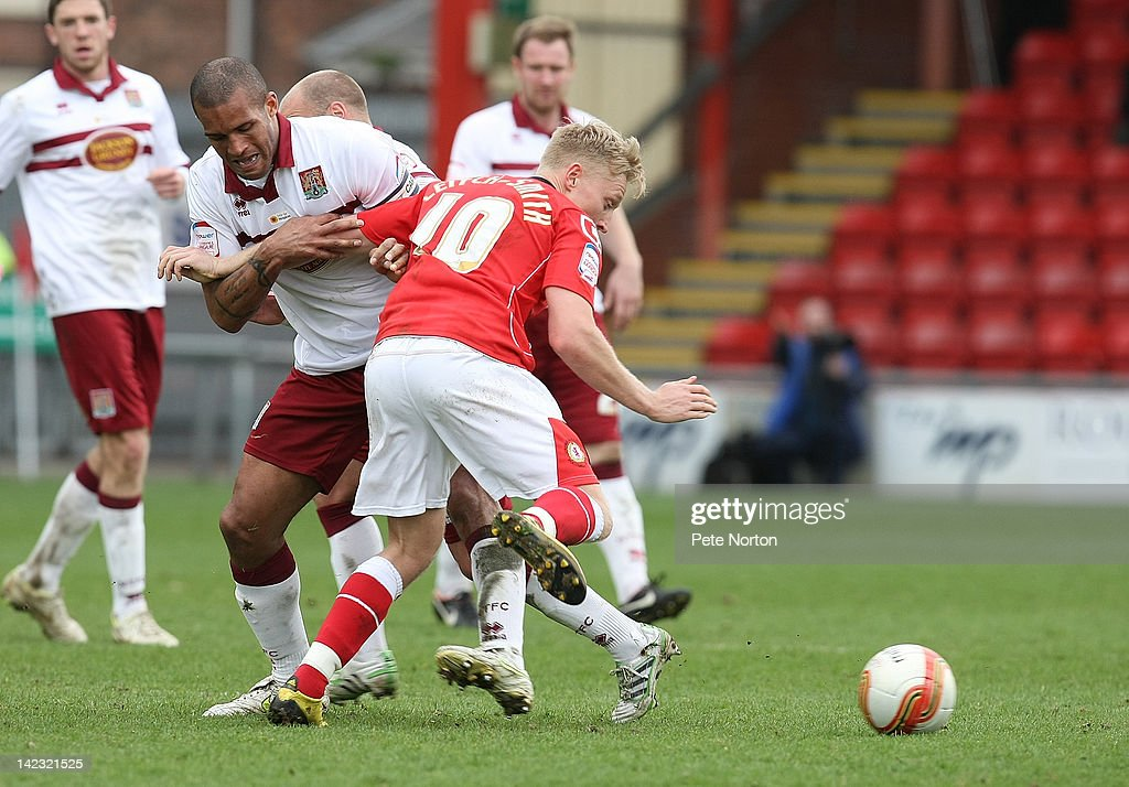 Clarke Carlisle of Northampton Town challenges for the ball with A-Jay Leitch-Smith of Crewe Alexandra during the npower League Two match between Crewe Alexandra and Northampton Town at The Alexandra Stadium on March 31, 2012 in Crewe, England.