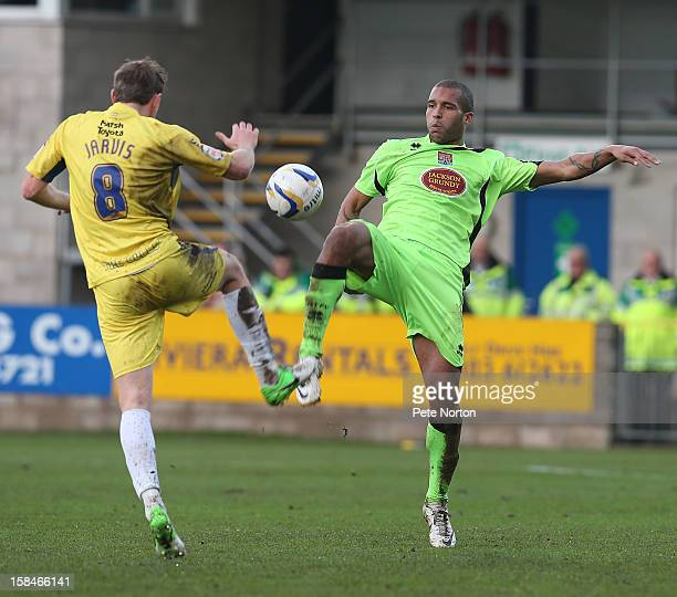 Clarke Carlisle of Northampton Town contests the ball with Ryan Jarvis of Torquay United during the npower League Two match between Torquay United...