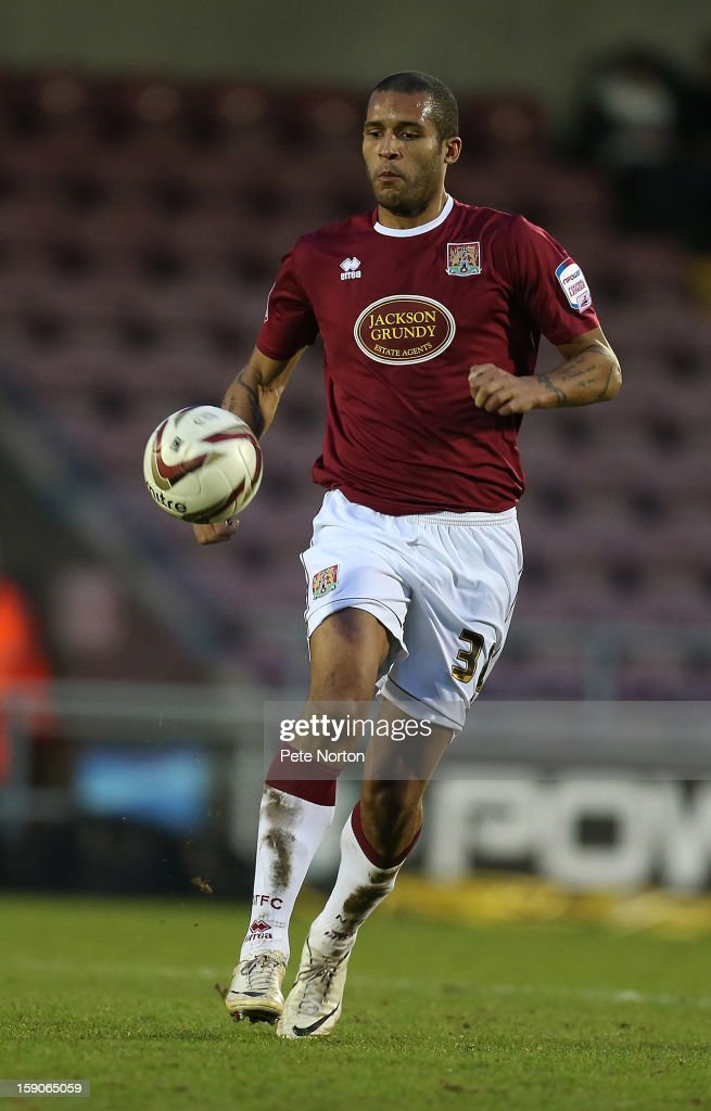 <a gi-track='captionPersonalityLinkClicked' href=/galleries/search?phrase=Clarke+Carlisle&family=editorial&specificpeople=204318 ng-click='$event.stopPropagation()'>Clarke Carlisle</a> of Northampton Town in action during the npower League Two match between Northampton Town and Fleetwood Town at Sixfields Stadium on January 5, 2013 in Northampton, England.