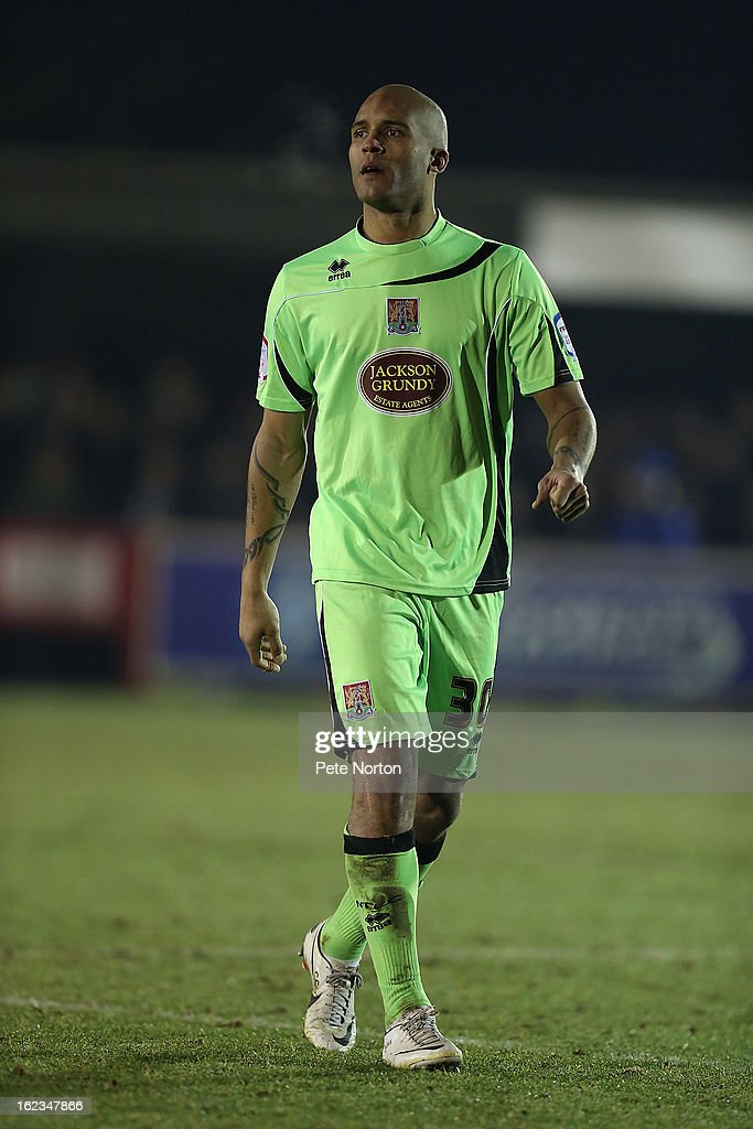 Clarke Carlisle of Northampton Town in action during the npower League Two match between AFC Wimbledon and Northampton Town at The Cherry Red Records Stadium on February 19, 2013 in Kingston upon Thames, England.