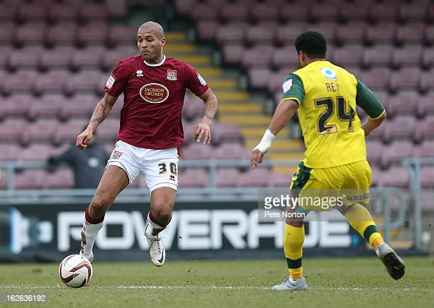 Clarke Carlisle of Northampton Town looks to control the ball watched by Reuben Reid of Plymouth Argyle during the npower League Two match between...