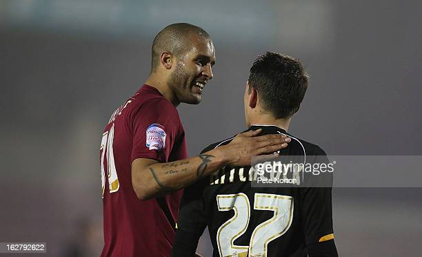 Clarke Carlisle of Northampton Town with Tom Hitchcock of Bristol Rovers during the npower League Two match between Northampton Town and Bristol...