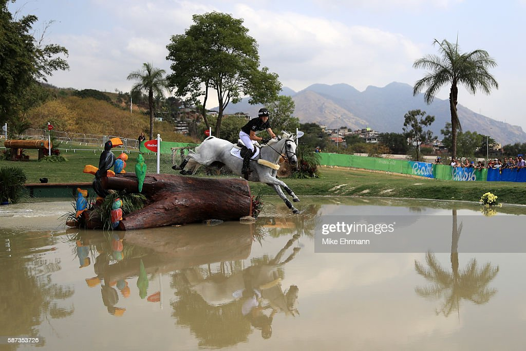 Clarke Johnstone of New Zealand riding Balmoral Sensation clears a jump during the Cross Country Eventing on Day 3 of the Rio 2016 Olympic Games at...