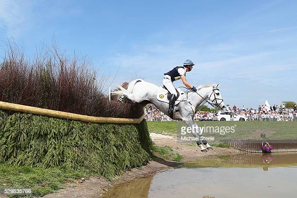 Clarke Johnstone of New Zealand riding Balmoral Sensation clears the lake fence during the crosscountry test on day four of the Badminton Horse...