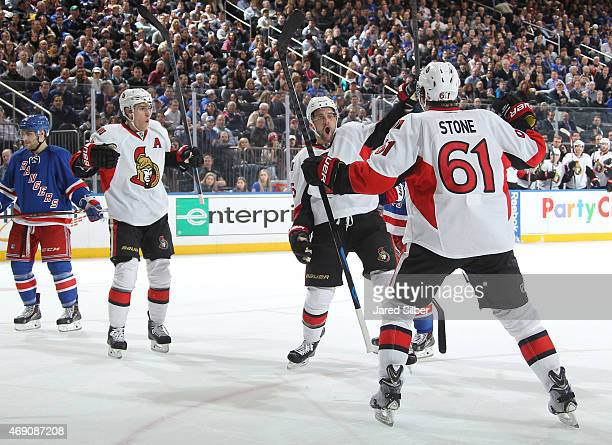 Clarke MacArthur Mark Stone and Kyle Turris of the Ottawa Senators celebrate after a second period goal against the New York Rangers at Madison...