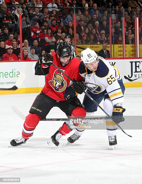 Clarke MacArthur of the Ottawa Senators battles for position against Brian Flynn of the Buffalo Sabres in the first period at Canadian Tire Centre on...