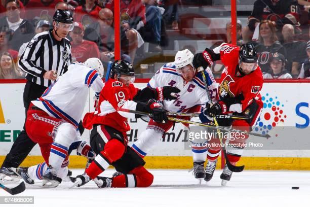 Clarke MacArthur of the Ottawa Senators battles for position against Ryan McDonagh of the New York Rangers as Derick Brassard of the Ottawa Senators...