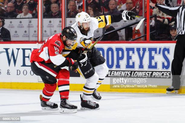 Clarke MacArthur of the Ottawa Senators battles for position against Nick Bonino of the Pittsburgh Penguins in Game Four of the Eastern Conference...