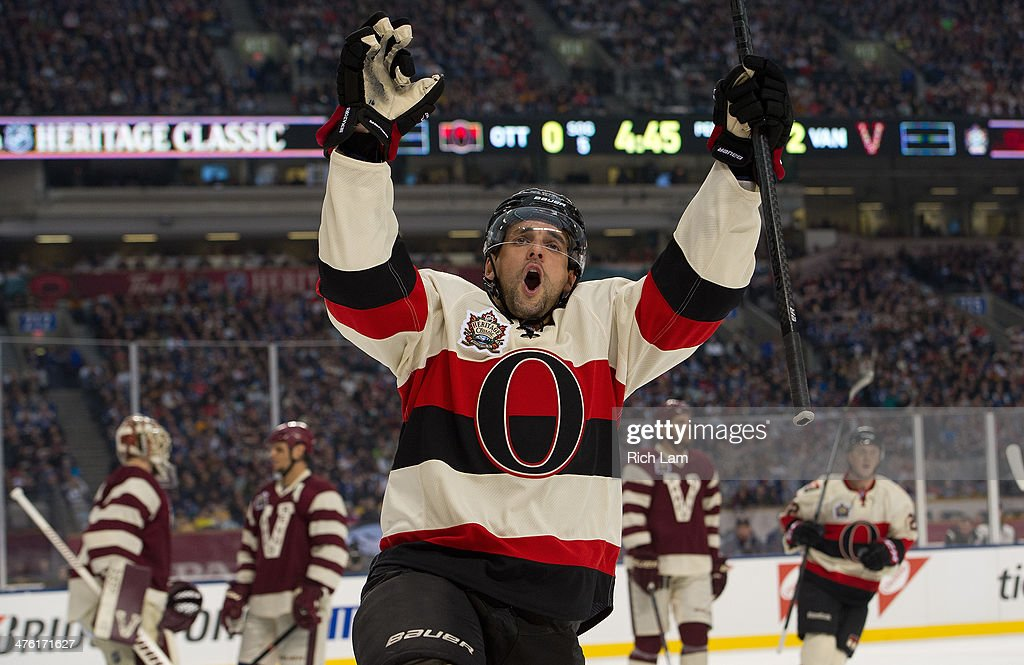 Clarke MacArthur #16 of the Ottawa Senators celebrates after scoring a goal during the first period in NHL action against the Vancouver Canucks on March 02, 2014 during the 2014 Tim Hortons Heritage Classic at BC Place Stadium in Vancouver, British Columbia, Canada.