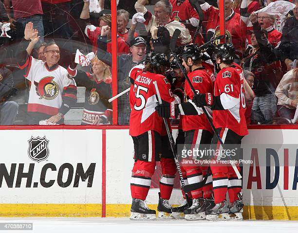 Clarke MacArthur of the Ottawa Senators celebrates his first period goal against the Montreal Canadiens with team mates Erik Karlsson Marc Methot and...