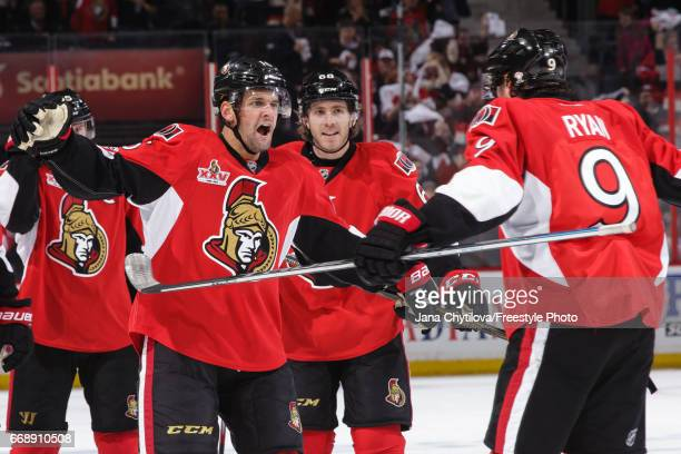 Clarke MacArthur of the Ottawa Senators celebrates his second period powerplay goal against the Boston Bruins with team mates Bobby Ryan and Mike...