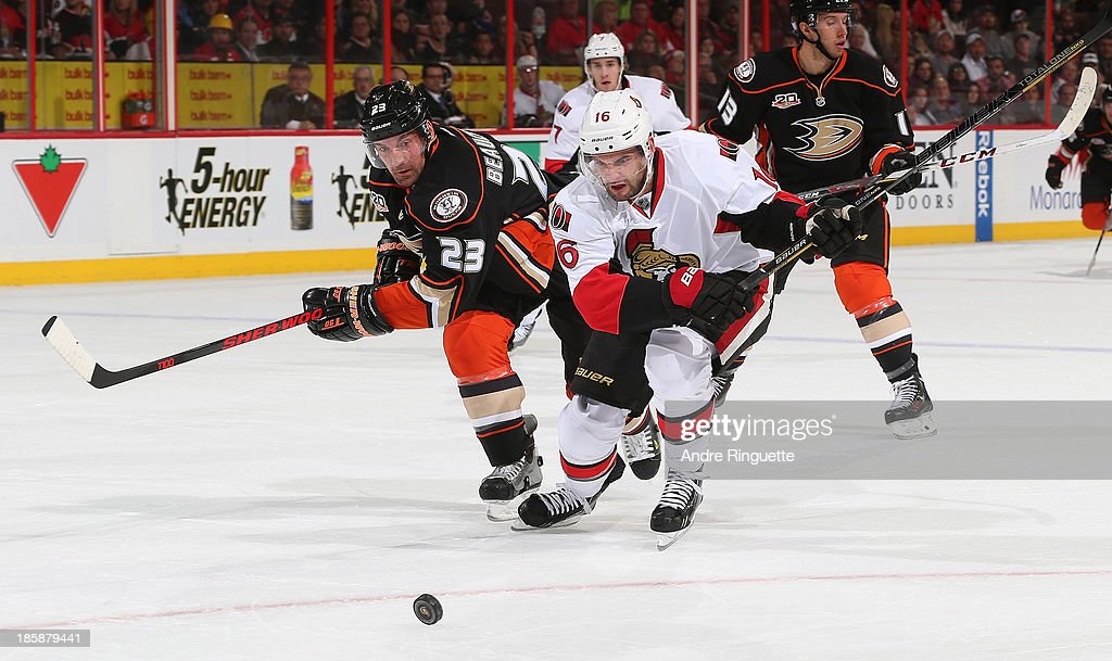 Clarke MacArthur #16 of the Ottawa Senators challenges for a loose puck on a shorthanded breakaway attempt against Francois Beauchemin #23 of the Anaheim Ducks at Canadian Tire Centre on October 25, 2013 in Ottawa, Ontario, Canada.