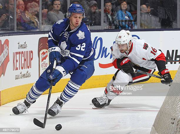 Clarke MacArthur of the Ottawa Senators chases after Martin Marincin of the Toronto Maple Leafs during an NHL game at the Air Canada Centre on...