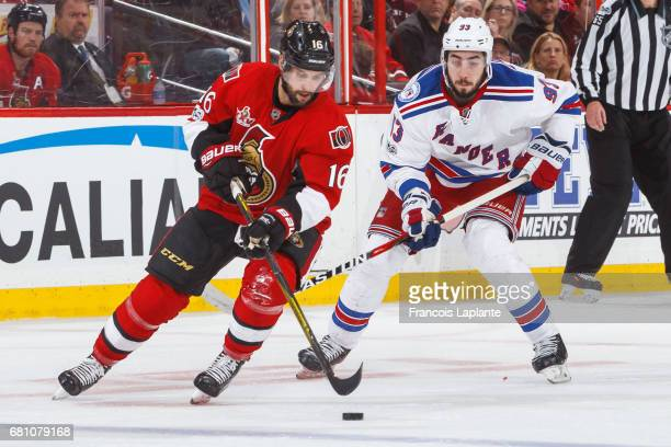 Clarke MacArthur of the Ottawa Senators controls the puck against Mika Zibanejad of the New York Rangers in Game Five of the Eastern Conference...