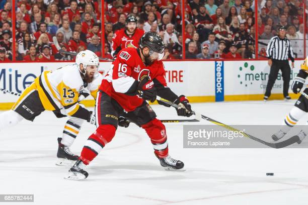 Clarke MacArthur of the Ottawa Senators controls the puck against Nick Bonino of the Pittsburgh Penguins in Game Three of the Eastern Conference...