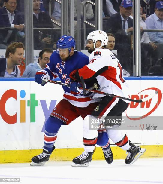 Clarke MacArthur of the Ottawa Senators holds on to Michael Grabner of the New York Rangers in Game Three of the Eastern Conference Second Round...