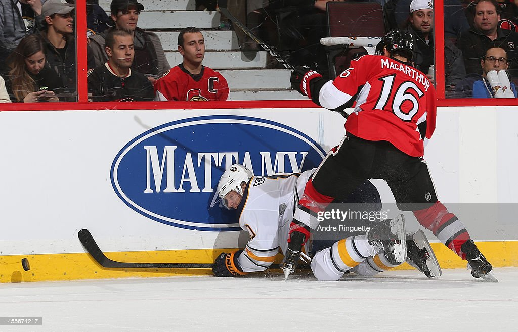 <a gi-track='captionPersonalityLinkClicked' href=/galleries/search?phrase=Clarke+MacArthur&family=editorial&specificpeople=3949382 ng-click='$event.stopPropagation()'>Clarke MacArthur</a> #16 of the Ottawa Senators knocks <a gi-track='captionPersonalityLinkClicked' href=/galleries/search?phrase=Christian+Ehrhoff&family=editorial&specificpeople=214788 ng-click='$event.stopPropagation()'>Christian Ehrhoff</a> #10 of the Buffalo Sabres off the puck and into the boards at Canadian Tire Centre on December 12, 2013 in Ottawa, Ontario, Canada.