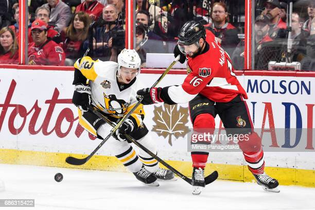 Clarke MacArthur of the Ottawa Senators plays the puck past Olli Maatta of the Pittsburgh Penguins in Game Four of the Eastern Conference Final...