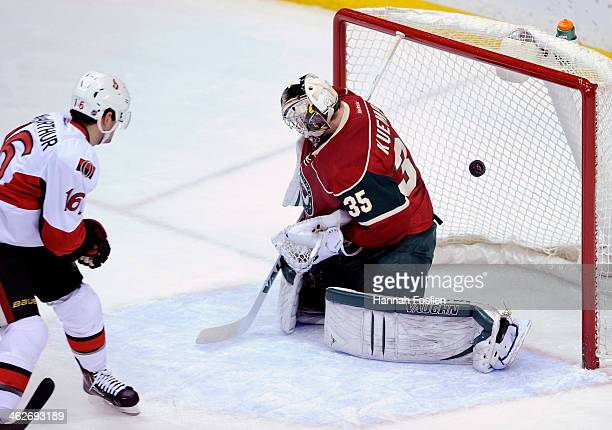 Clarke MacArthur of the Ottawa Senators scores a goal against Darcy Kuemper of the Minnesota Wild during the first period of the game on January 14...