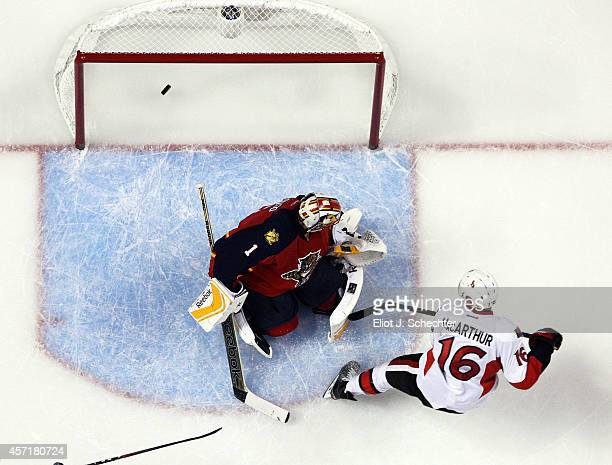 Clarke MacArthur of the Ottawa Senators shoots and scores against Goaltender Roberto Luongo of the Florida Panthers at the BBT Center on October 13...