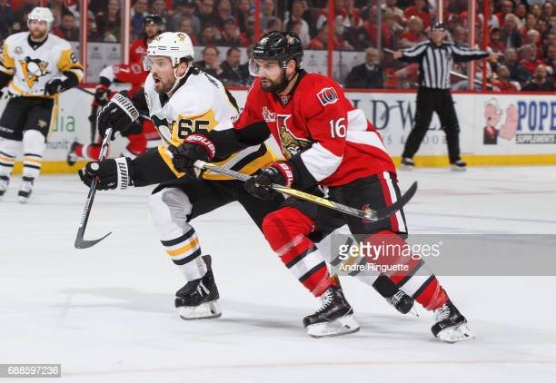 Clarke MacArthur of the Ottawa Senators skates against Ron Hainsey of the Pittsburgh Penguins in Game Six of the Eastern Conference Final during the...