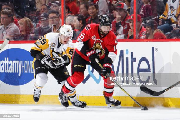 Clarke MacArthur of the Ottawa Senators skates with the puck against Jake Guentzel of the Pittsburgh Penguins in Game Four of the Eastern Conference...