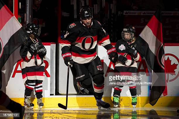 Clarke MacArthur of the Ottawa Senators steps onto the ice during player introductions prior to an NHL game against the Montreal Canadiens at...