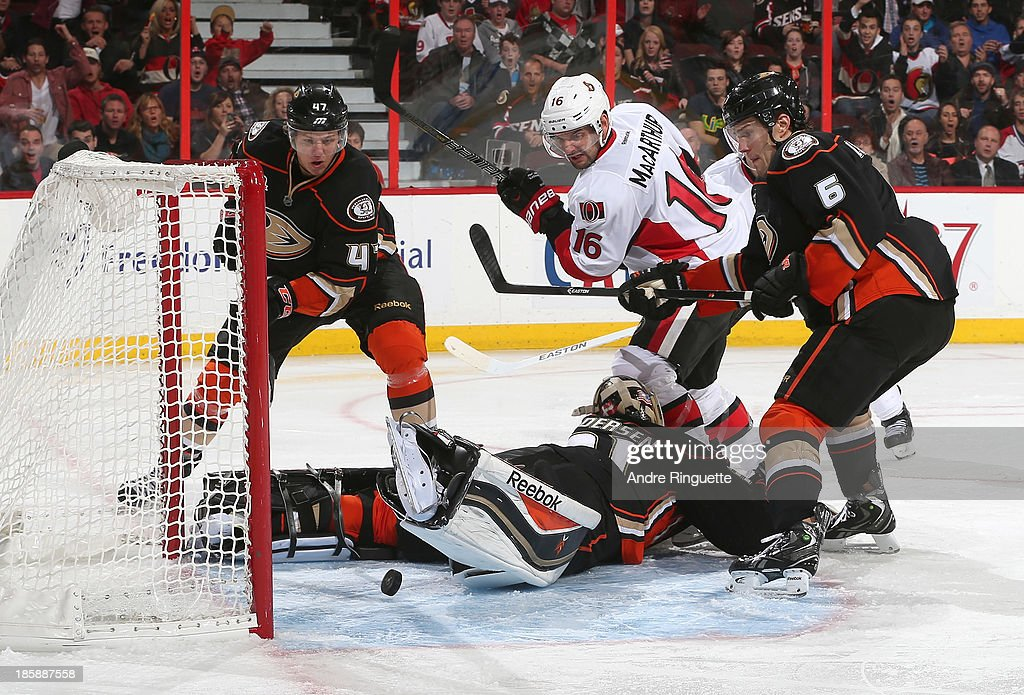 <a gi-track='captionPersonalityLinkClicked' href=/galleries/search?phrase=Clarke+MacArthur&family=editorial&specificpeople=3949382 ng-click='$event.stopPropagation()'>Clarke MacArthur</a> #16 of the Ottawa Senators watches as the puck slides across the crease behind Frederik Andersen #31 of the Anaheim Ducks while <a gi-track='captionPersonalityLinkClicked' href=/galleries/search?phrase=Hampus+Lindholm&family=editorial&specificpeople=8630299 ng-click='$event.stopPropagation()'>Hampus Lindholm</a> #47 and <a gi-track='captionPersonalityLinkClicked' href=/galleries/search?phrase=Ben+Lovejoy&family=editorial&specificpeople=4509565 ng-click='$event.stopPropagation()'>Ben Lovejoy</a> #6 of the Ducks protect the rebound at Canadian Tire Centre on October 25, 2013 in Ottawa, Ontario, Canada.
