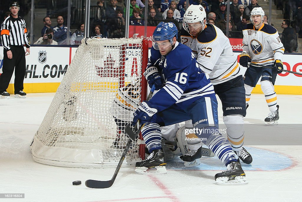 <a gi-track='captionPersonalityLinkClicked' href=/galleries/search?phrase=Clarke+MacArthur&family=editorial&specificpeople=3949382 ng-click='$event.stopPropagation()'>Clarke MacArthur</a> #16 of the Toronto Maple Leafs drives the net on <a gi-track='captionPersonalityLinkClicked' href=/galleries/search?phrase=Alexander+Sulzer&family=editorial&specificpeople=673531 ng-click='$event.stopPropagation()'>Alexander Sulzer</a> #52 of the Buffalo Sabres during NHL action at the Air Canada Centre February 21, 2013 in Toronto, Ontario, Canada.
