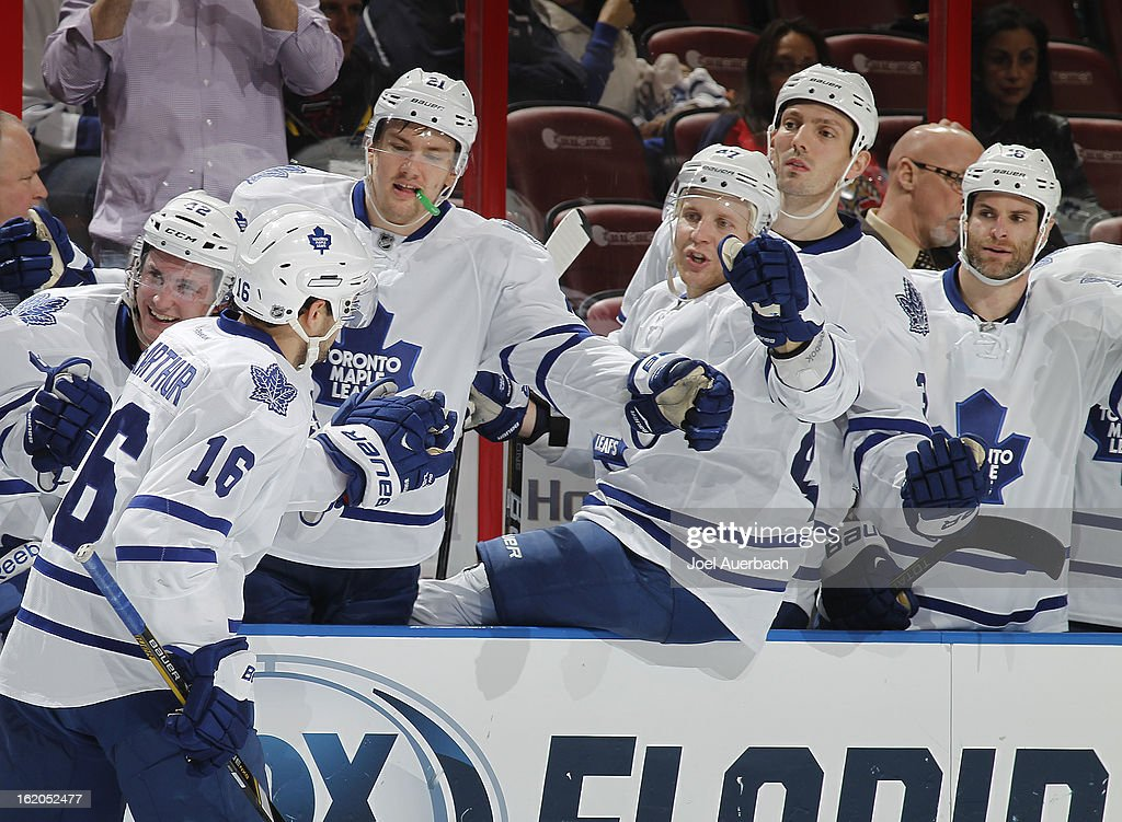 Clarke MacArthur #16 of the Toronto Maple Leafs is congratulated by teammates after scoring a second period goal against the Florida Panthers at the BB&T Center on February 18, 2013 in Sunrise, Florida.