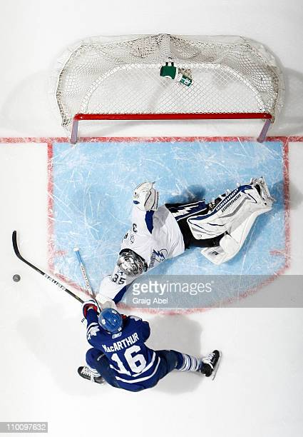 Clarke MacArthur of the Toronto Maple Leafs is stopped in close by Dwayne Roloson of the Tampa Bay Lightning March 14 2011 at the Air Canada Centre...