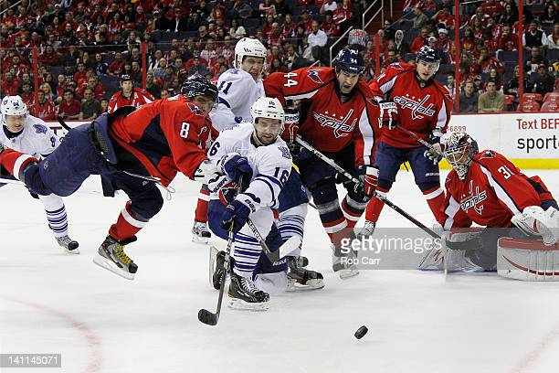 Clarke MacArthur of the Toronto Maple Leafs passes the puck in front of Alex Ovechkin of the Washington Capitals during the second period at the...