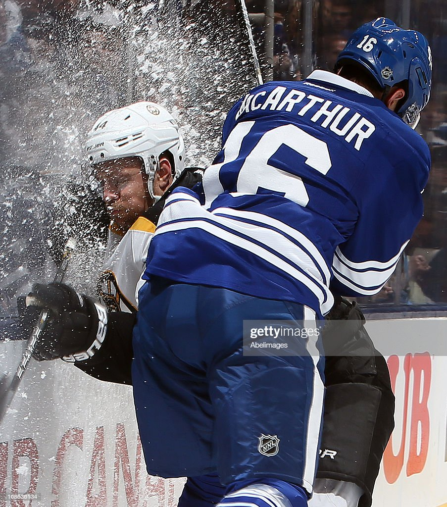 <a gi-track='captionPersonalityLinkClicked' href=/galleries/search?phrase=Clarke+MacArthur&family=editorial&specificpeople=3949382 ng-click='$event.stopPropagation()'>Clarke MacArthur</a> #16 of the Toronto Maple Leafs runs into <a gi-track='captionPersonalityLinkClicked' href=/galleries/search?phrase=Dennis+Seidenberg&family=editorial&specificpeople=204616 ng-click='$event.stopPropagation()'>Dennis Seidenberg</a> #44 of the Boston Bruins in Game Six of the Eastern Conference Quarterfinals during the 2013 NHL Stanley Cup Playoffs May 12, 2013 at the Air Canada Centre in Toronto, Ontario, Canada.