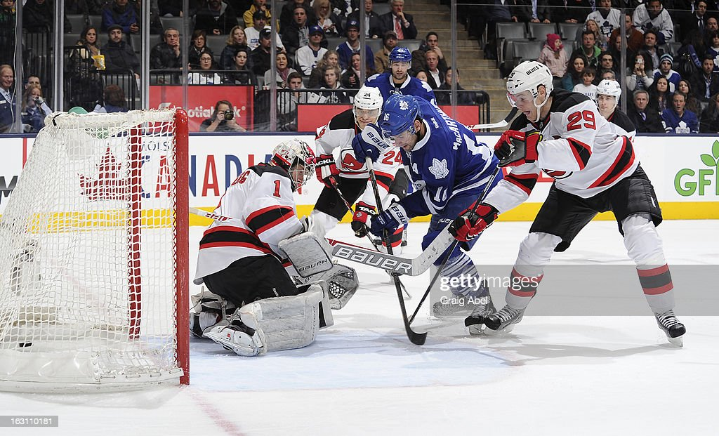 <a gi-track='captionPersonalityLinkClicked' href=/galleries/search?phrase=Clarke+MacArthur&family=editorial&specificpeople=3949382 ng-click='$event.stopPropagation()'>Clarke MacArthur</a> #16 of the Toronto Maple Leafs scores a third period goal as <a gi-track='captionPersonalityLinkClicked' href=/galleries/search?phrase=Johan+Hedberg&family=editorial&specificpeople=202078 ng-click='$event.stopPropagation()'>Johan Hedberg</a> #1 and Mark Fayne #29 of the New Jersey Devils defend during NHL game action March 4, 2013 at the Air Canada Centre in Toronto, Ontario, Canada.