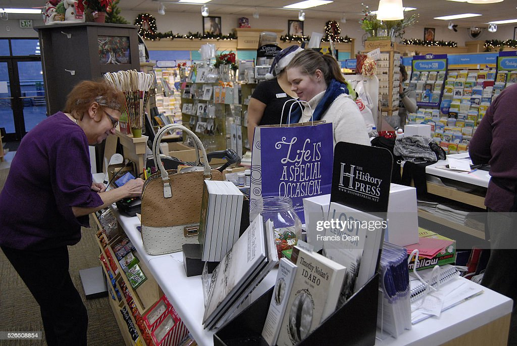 Clarkston Washington state USA _Lady doing her last mintue christmas gifts shopping on christmas eve at christmas gift shop 24 December 2014