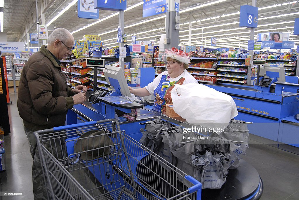 Clarkston Washington state USA_Americans shopping on christmas eve at Walmar store and cashier wearing santa claus hat in christmas celebration mode...