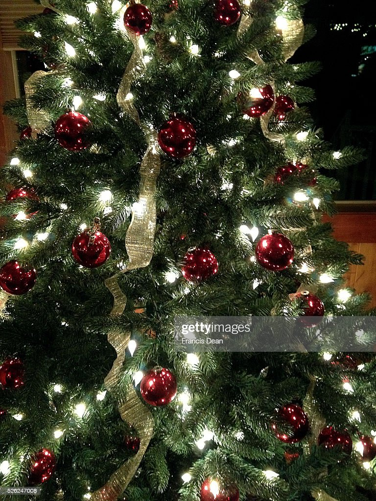 Clarkston/washington State /USA_ 13 December 2015 _ American decorate christmas tree with alot of live lights and colour full ornaments