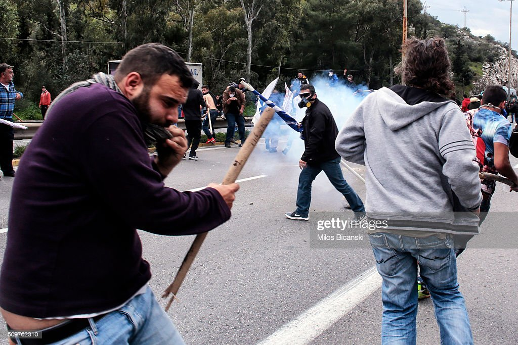 Clashes break out on the highway after police blocked the road from a planned pension reform protest outside the Agriculture ministry on February 12, 2016 in Athens, Greece. Around reportedly 800 protesters from Crete gathered outnumbering police who were armed with teargas.