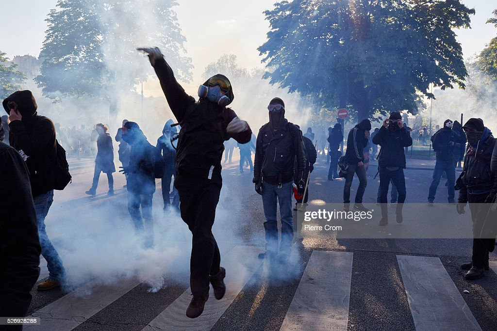 Clashes erupt between police and protesters during a May Day rally on May 01, 2016 in Paris, France. Violence broke out as people took to the streets to demonstrate against proposed labour law reforms.