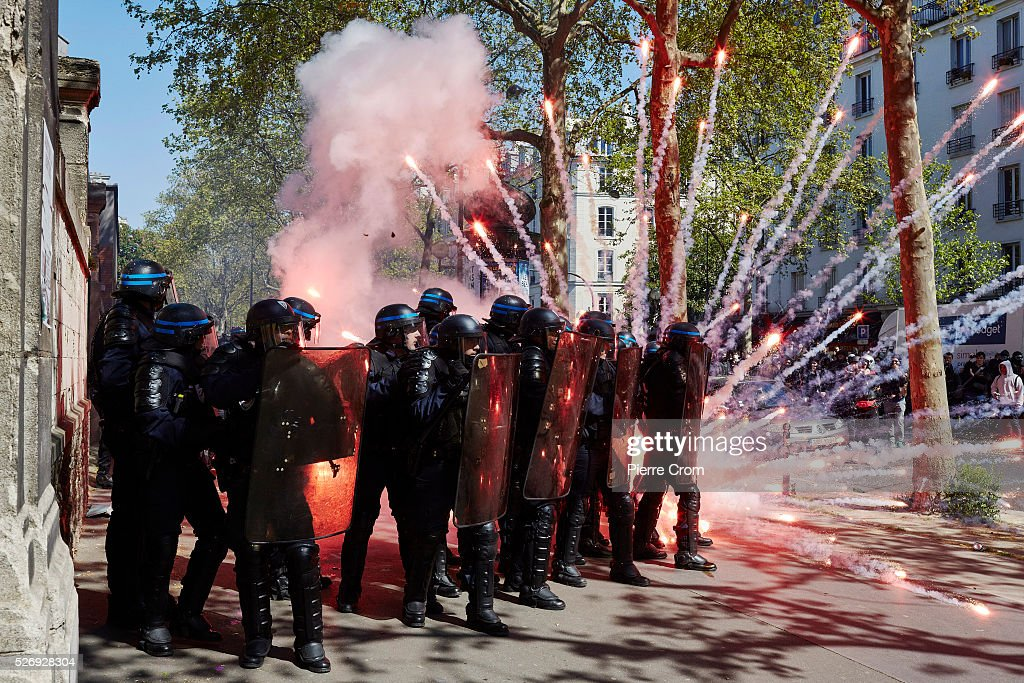 Αποτέλεσμα εικόνας για French police and protesters clash in Paris during May Day rally