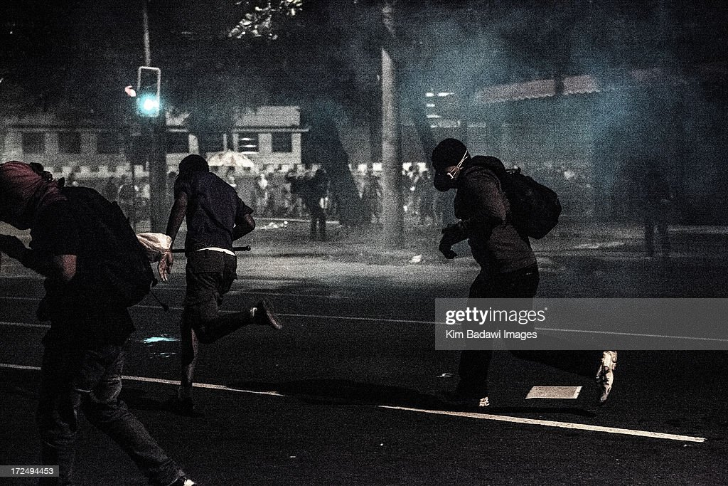 Clashes with riot squad officers and protesters in streets near Maracana stadium in Rio de Janeiro, Brazil on June 30, 2013, a few hours before the final of the FIFA Confederations Cup football tournament between Brazil and Spain. More than 11,000 police and troops were mobilized in the city to guarantee security for 78,000 fans at the venue as the curtain falls on a competition that has been beset by social unrest with more than 1.5 million people taking to the streets across the giant nation in the past two weeks.