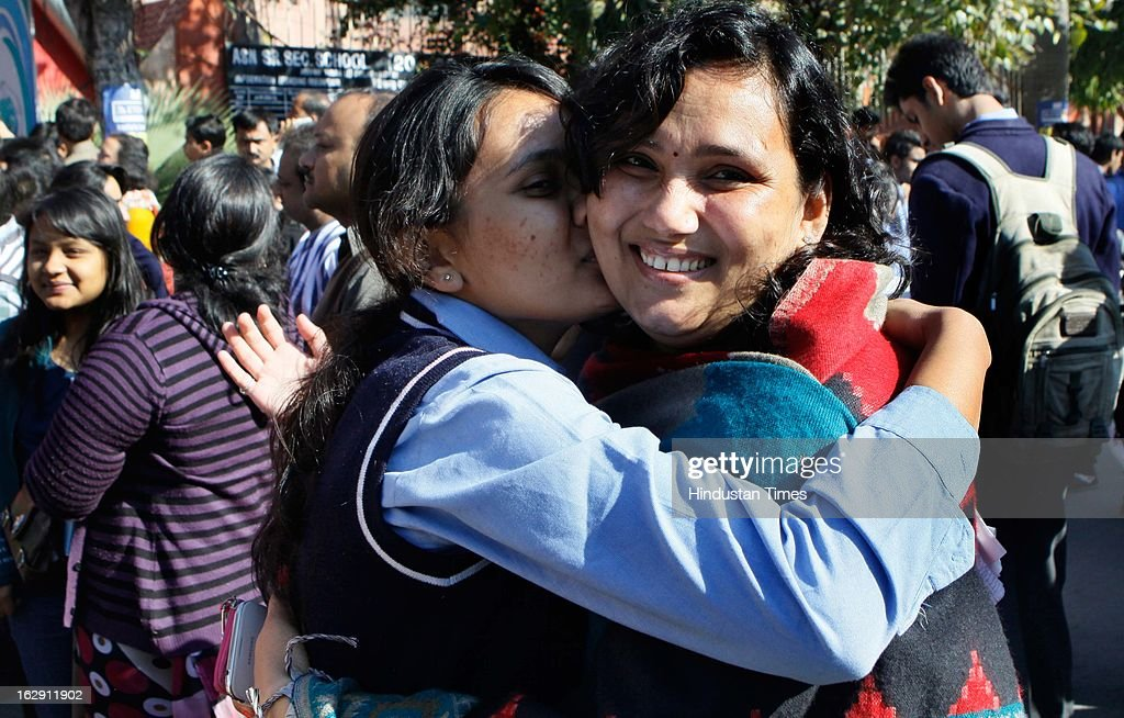 Class 12th student hugs her mother before her English exam at Mayur Vihar on March 1, 2013 in New Delhi, India. Over all 22 lakh students are appearing for their CBSE exam for Class X and XII this year.